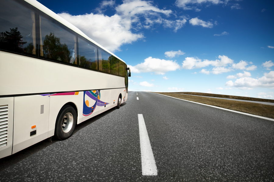 Private hire bus from limousine company transporting passengers