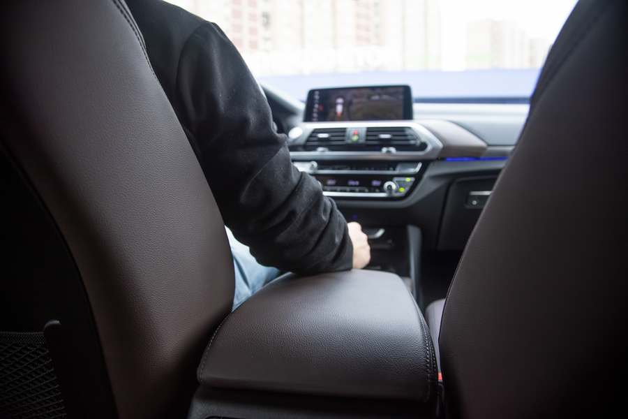 Professional driver from limousine service sitting in front seat