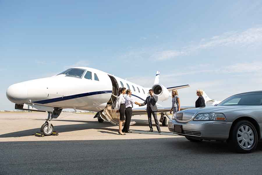 chauffeur service singapore picking VIPs at airport chartered flight