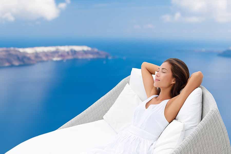 lady enjoying luxury hotel experience by the sea