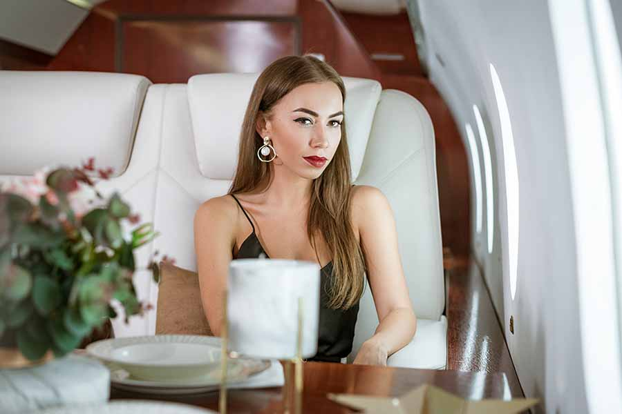 wealthy lady enjoying a private jet experience